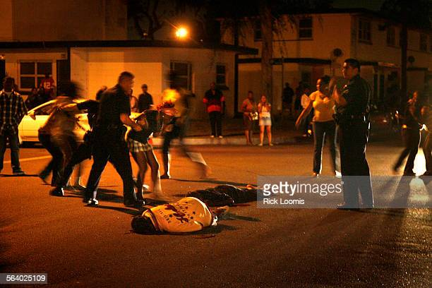 Los Angeles Ca – LAPD gang officers try to control the scene of a double shooting that took place in Nickerson Gardens which borders both Watts and...