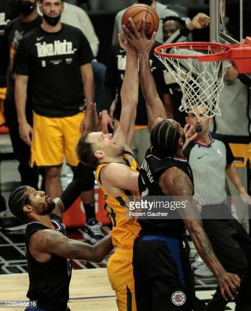 Los Angeles, CA, Monday, June 14, 2021 - LA Clippers forward Kawhi Leonard blocks the shot of Utah Jazz guard Joe Ingles in game four of the NBA...