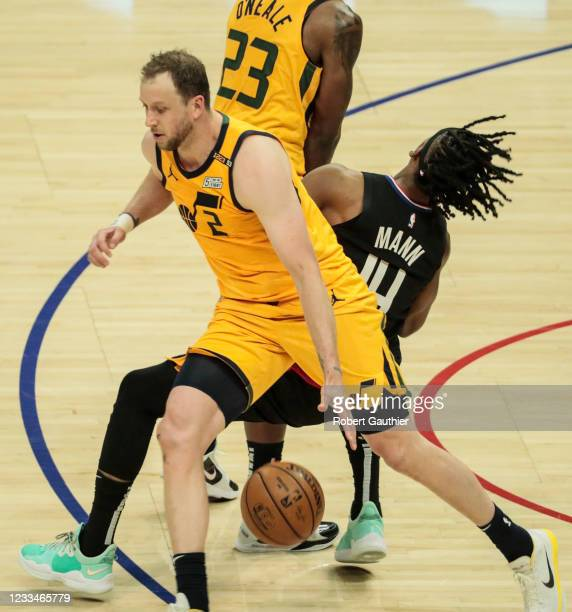Los Angeles, CA, Monday, June 14, 2021 - LA Clippers guard Terance Mann is knocked to the floor by Utah Jazz forward Royce O'Neale as he chases Utah...