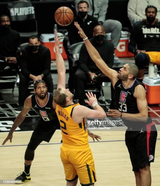 Los Angeles, CA, Monday, June 14, 2021 - Utah Jazz guard Joe Ingles shoots over LA Clippers forward Nicolas Batum in game four of the NBA Western...