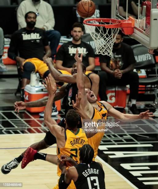 Los Angeles, CA, Monday, June 14, 2021 - Utah Jazz guard Joe Ingles struggles to shoot over LA Clippers forward Kawhi Leonard late in game four of...