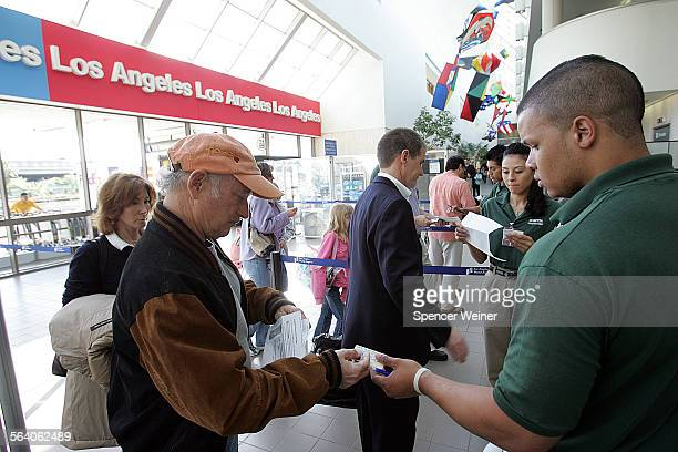 Los Angeles Ca– Passengers have the identification and tickets checked at first security screening area at LAX terminal One Tuesday March 6 2007...