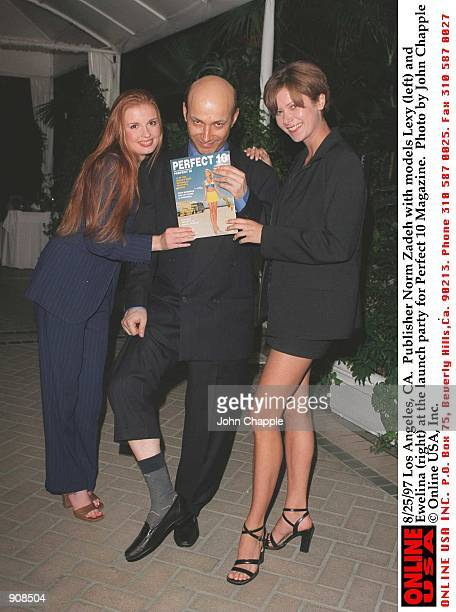 Los Angeles CA Publisher Norm Zadeh poses with models Lexy and Ewelina at the launch party for Perfect 10 Magazine