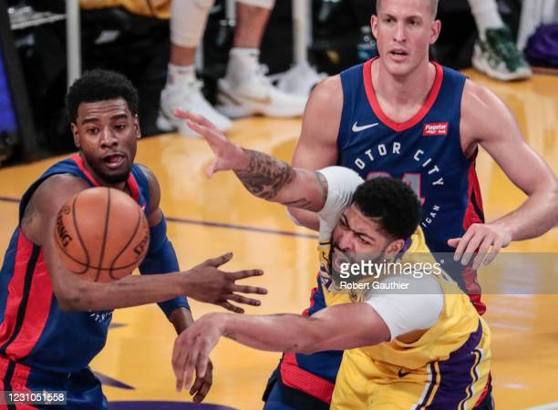 Los Angeles, CA, Saturday, February 6, 2021 - Los Angeles Lakers forward Anthony Davis struggles to pass the ball while being defended by Detroit...