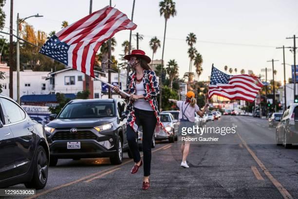 Los Angeles, CA, Saturday, November 7, 2020 - Katherine Fairfax Wright, left and Katy Wicker dance along the median on Sunset Blvd., celebrating the...
