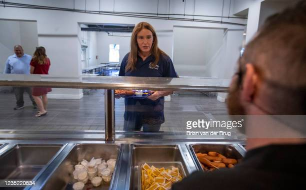 Los Angeles, CA - September 11,2021: Republican gubernatorial candidate Caitlyn Jenner grabs a lunch tray during a tour of the Los Angeles Dream...