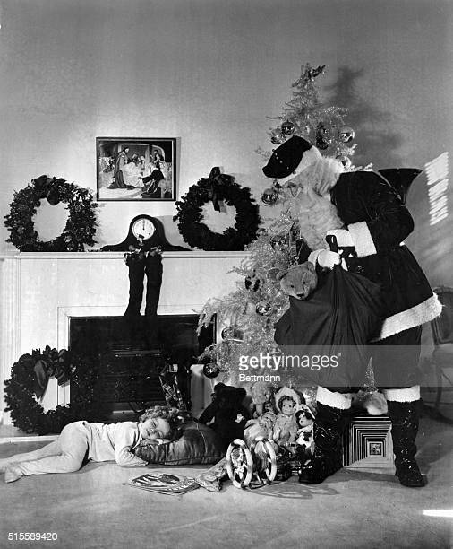 12/3/1934 Los Angeles CA The clock on the mantelpiece says twelvelong after good little girls should be in bed and Shirley Temple although not snug...