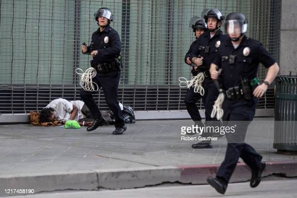 Los Angeles, CA, Tuesday, June 2, 2020 - A phalanx of LAPD officers rush to arrest dozens of George Floyd protesters who were violating curfew laws...