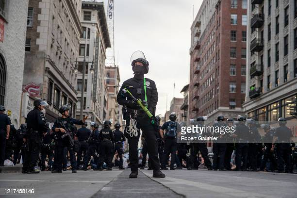 Los Angeles, CA, Tuesday, June 2, 2020 - LAPD officer Decote watches for people tossing debris from tall buildings as dozens of protesters are...