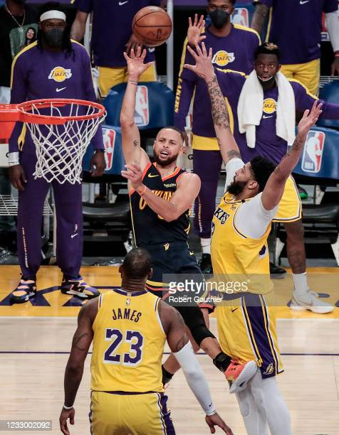 Los Angeles, CA, Wednesday, May 19, 2021 _ Golden State Warriors guard Stephen Curry shoots over Los Angeles Lakers forward Anthony Davis during...