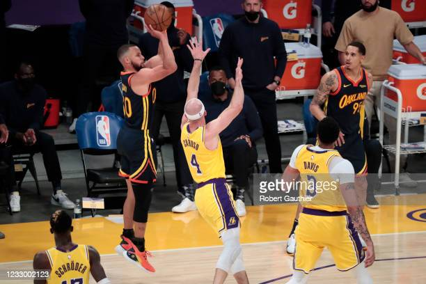 Los Angeles, CA, Wednesday, May 19, 2021 _ Golden State Warriors guard Stephen Curry makes a three pointer over Los Angeles Lakers guard Alex Caruso...