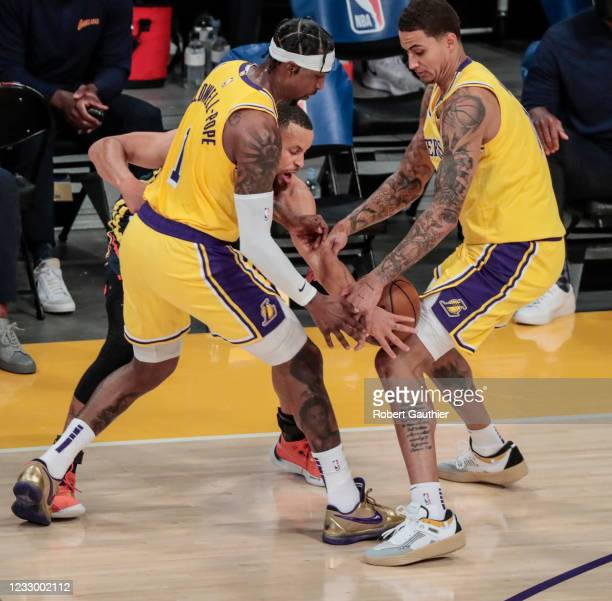 Los Angeles, CA, Wednesday, May 19, 2021 _ Kyle Kuzma, right, and Kentavious Caldwell-Pope steal the ball from Warriors guard Steph Curry in a Pay-In...