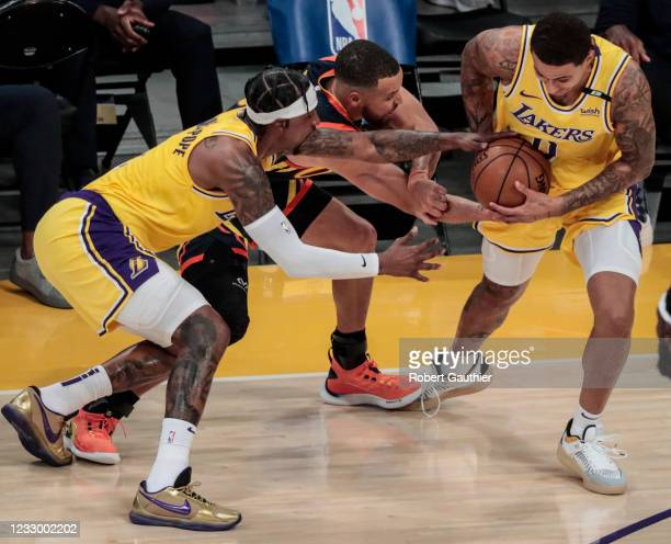 Los Angeles, CA, Wednesday, May 19, 2021 _ Los Angeles Lakers forward Kyle Kuzma and Los Angeles Lakers guard Kentavious Caldwell-Pope steal the ball...