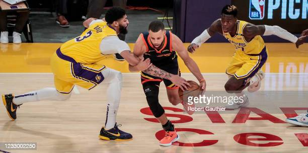 Los Angeles, CA, Wednesday, May 19, 2021 _ Los Angeles Lakers forward Anthony Davis fouls Golden State Warriors guard Stephen Curry during second...