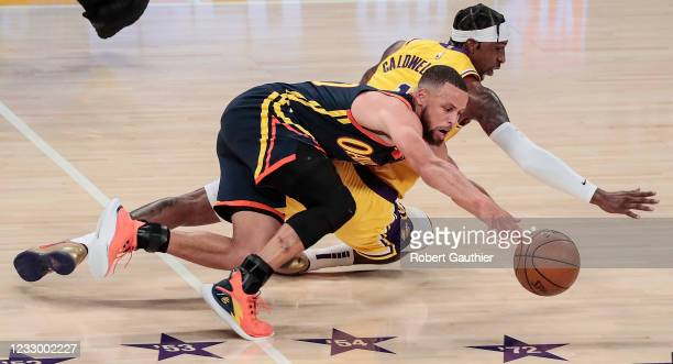 Los Angeles, CA, Wednesday, May 19, 2021 _ Los Angeles Lakers guard Kentavious Caldwell-Pope forces Golden State Warriors guard Stephen Curry into a...