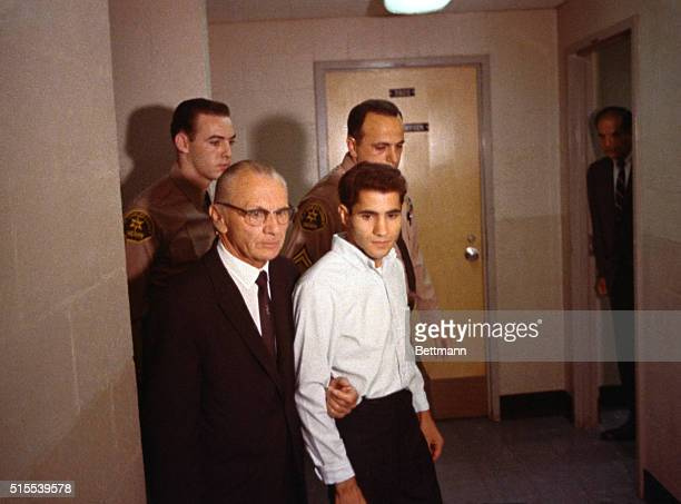 Sirhan B Sirhan and his attorney Russell E Parsons are photographed as they leave the courtroom following the hearing postponed until July 19th when...