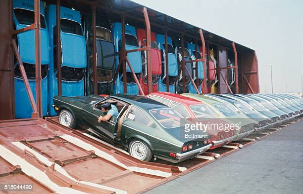 Los Angeles California A giant railroad car which carries 30 subcompact automobiles vertically so they stand on end front bumper down finished its...
