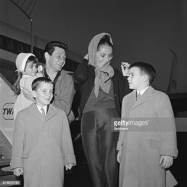 Los Angeles California Actress Elizabeth Taylor still recovering from her nearfatal illness greets her three children at the airport with her husband...