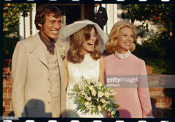 Los Angeles California At the wedding of David Lee Burk and Melissa Ann Montgomery the bride and groom are shown with the bride's mother Dinah Shore...