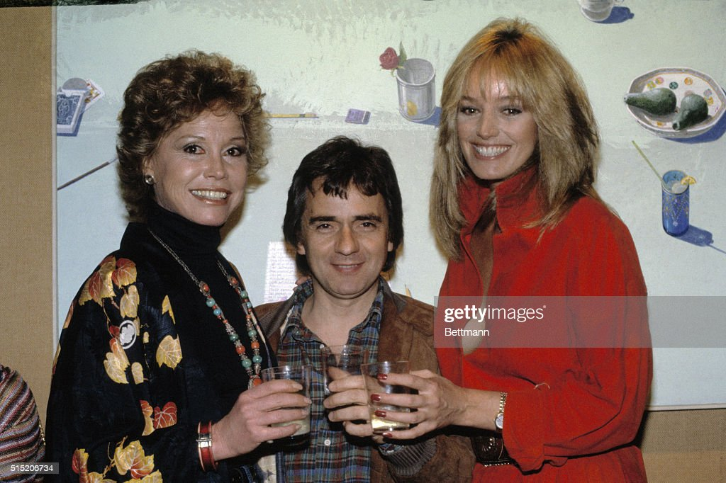 Dudley Moore Sharing a Toast with Mary Tyler Moore : News Photo