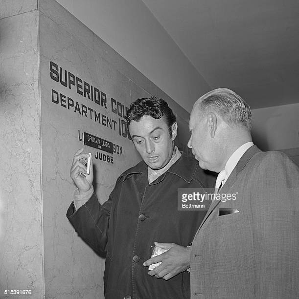 Los Angeles, California: Lenny Bruce with attorney John Marshall after judge orders an examination to determine whether or not he is a drug addict.