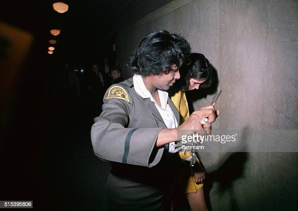 Los Angeles California Leslie Louis Van Houghten is taken by policewomen to a jail cell in the Hall of Justice after she and two other girls waive...