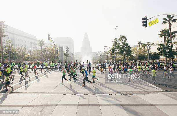 Los Angeles, California - March 17,2013: Runners compete near Los Angeles City Hall during the Los Angeles Marathon on March 17, 2013. The marathon...
