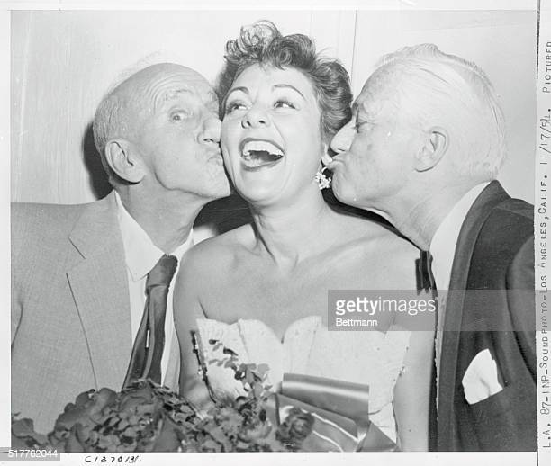Los Angeles California Pictured backstage following her initial performance at Club Mocambo Lilian Roth receives congratulations from Jimmy Durante...