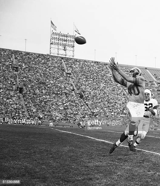 """Los Angeles, California: Snaring A Pass. Elroy """"Crazy Legs"""" Hirsch Los Angeles Rams' end, reaches to snare a pass on the Cleveland Browns' 37 yard..."""