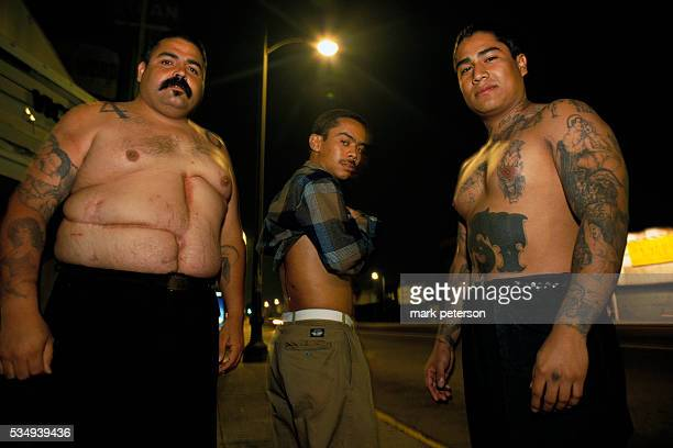 Los Angeles California South Central LA 40th Street Gang members show off scars from bullet wounds