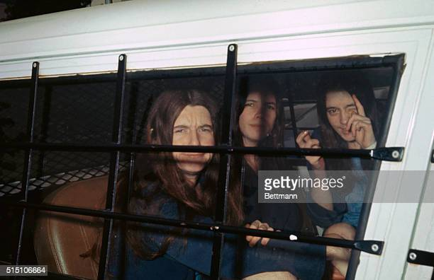 Los Angeles California The three female members of Charles Manson's 'family' ham it up for photographers through the window of the sheriff's van as...