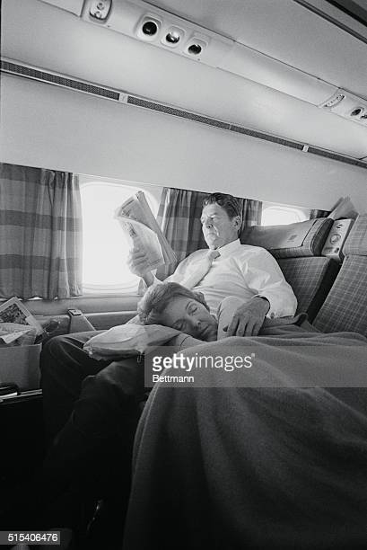 Los Angeles California Tired campaigner Nancy Reagan catches '40 winks' on her husband's lap during flight returning them to California from a trip...
