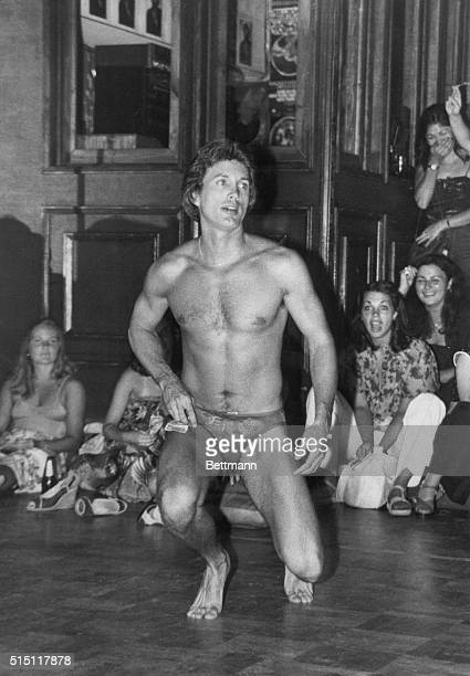 Los Angeles California With tips of dollar bills from the audience stuffed inside his briefs a male exotic dancer entertains crowds of women at...