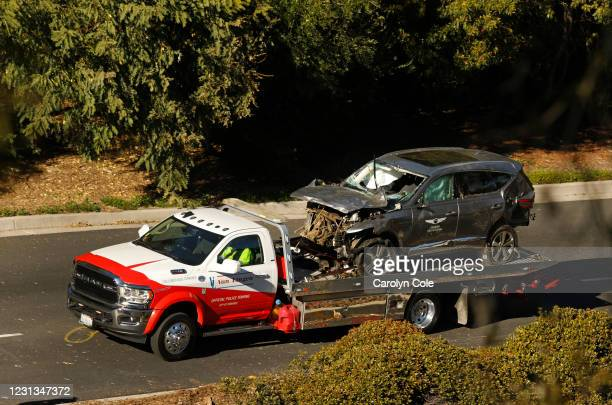 Los Angeles, California-The vehicle driven by Tiger Woods is towed away on Hawthorne Blvd after he ran off the road and sustained injuries.
