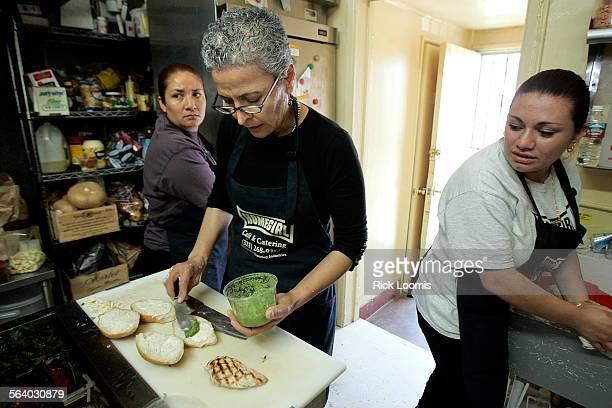 Los Angeles Ca–Patty Zarate center manager of the Homegirl Cafe in East Los Angeles prepares meals for a busy lunchtime crowd at the popular East Los...