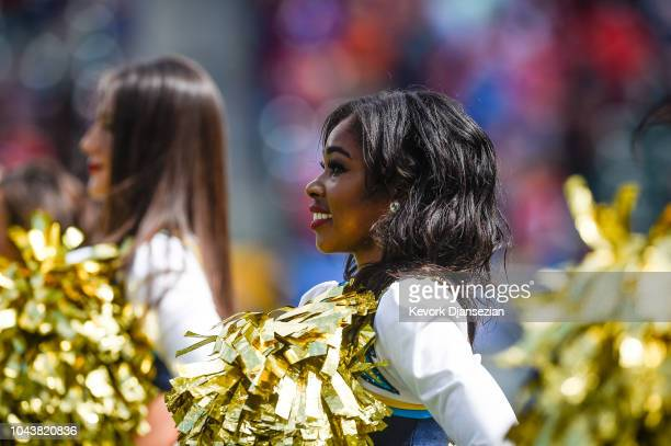 Los Angeles Chargers cheerleaders stand during the national anthem at StubHub Center ahead of the game against the San Francisco 49ers on September...