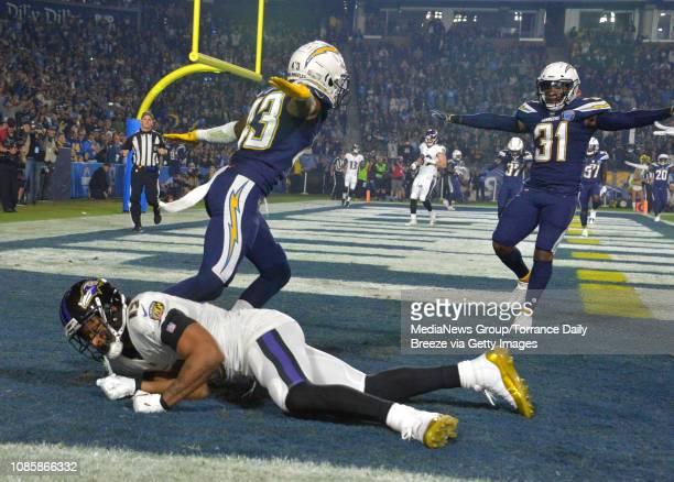 Los Angeles Chargers cornerback Michael Davis celebrates with Adrian Phillips after breaking up a pass in the end zone to Baltimore Ravens wide...