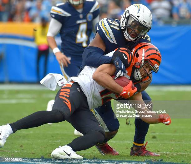 Los Angeles Chargers defensive back Adrian Phillips tackles Cincinnati Bengals kick returner Alex Erickson at StubHub Center in Carson on Sunday Dec...