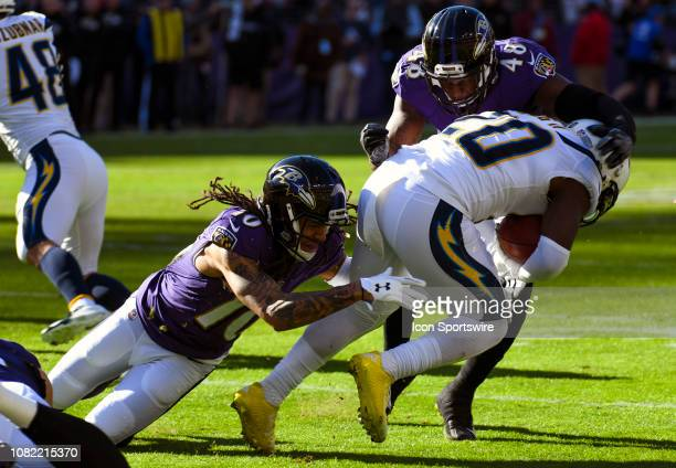 Los Angeles Chargers defensive back Desmond King fields a punt and is brought down by Baltimore Ravens wide receiver Chris Moore and inside...