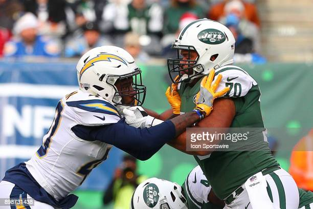 Los Angeles Chargers defensive end Chris McCain battles New York Jets offensive guard Dakota Dozier during the National Football League game between...