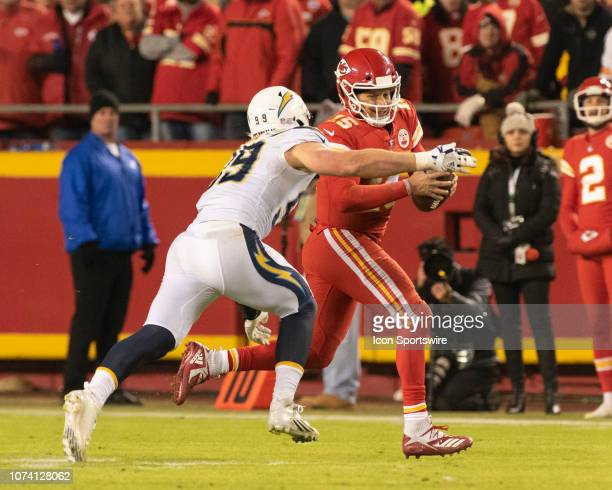 Los Angeles Chargers Defensive End Joey Bosa puts pressure open Kansas City Chiefs Quarterback Patrick Mahomes during the NFL game between the Los...