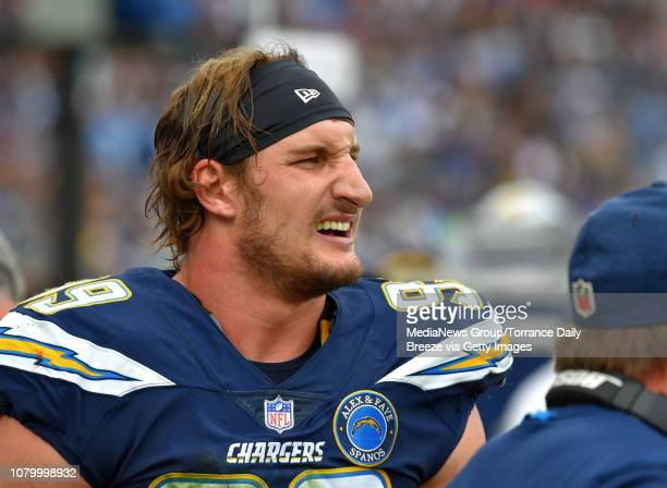 Los Angeles Chargers defensive end Joey Bosa watches the offense on the field at StubHub Center in Carson on Sunday Dec 9 2018
