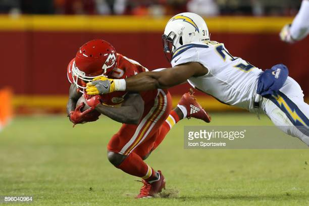 Los Angeles Chargers free safety Adrian Phillips dives to tackle Kansas City Chiefs wide receiver Tyreek Hill in the second quarter of a week 15 NFL...