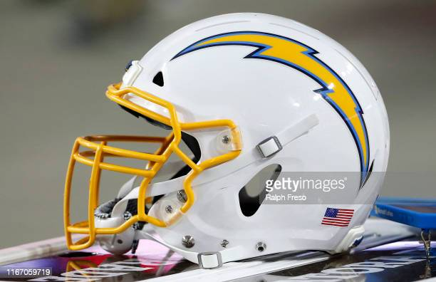 Los Angeles Chargers helmet on the sidelines prior to the start of the NFL preseason game the Arizona Cardinals at State Farm Stadium on August 08...