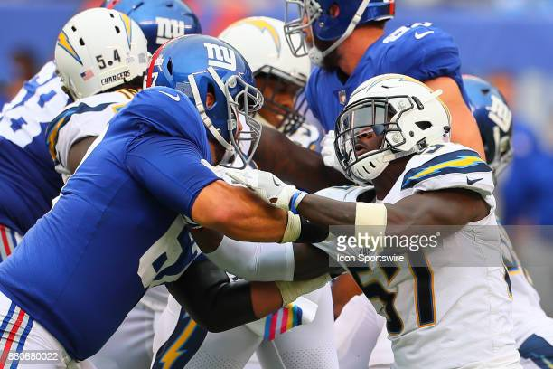 Los Angeles Chargers inside linebacker Jatavis Brown battles New York Giants offensive tackle Justin Pugh during the National Football League game...
