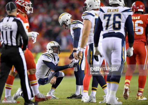 Los Angeles Chargers kicker Travis Coons is consoled by holder Drew Kaser after a missed PAT in the second quarter against the Kansas City Chiefs on...