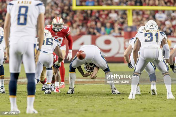Los Angeles Chargers Long Snapper Mike Windt snaps the ball to Los Angeles Chargers Punter Drew Kaser during a preseason NFL game between the Los...