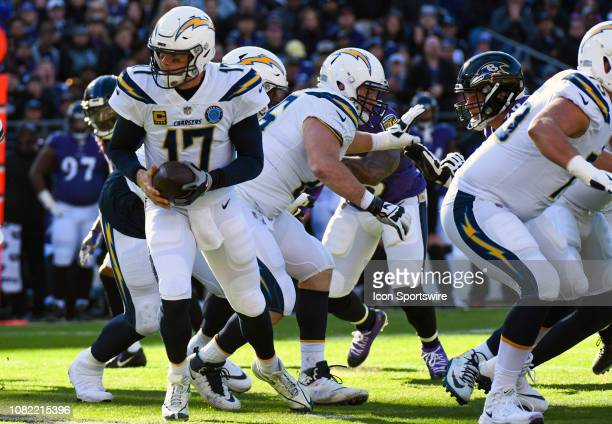 Los Angeles Chargers quarterback Philip Rivers moves to hand the ball off against the Baltimore Ravens on January 6 at MT Bank Stadium in Baltimore MD