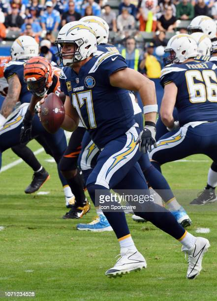 Los Angeles Chargers quarterback Philip Rivers scrambles with the ball for a gain of yards in the first quarter of an NFL football game against the...