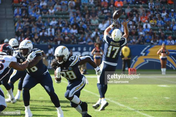 Los Angeles Chargers Quarterback Philip Rivers tries to pull down a bad snap during an NFL football game between the Denver Broncos and the Los...